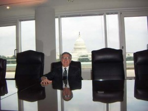 Don sitting in a client's boardroom overlooking the Capital